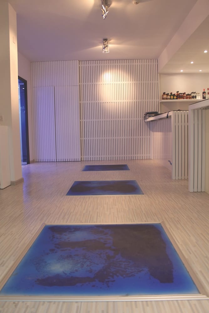 entrance responsive liquid floor tiles nighttime