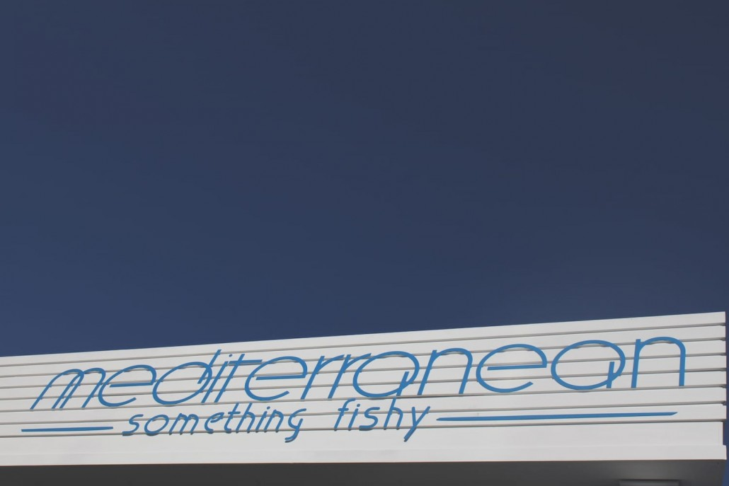 Mediterranean something fishy logo sign