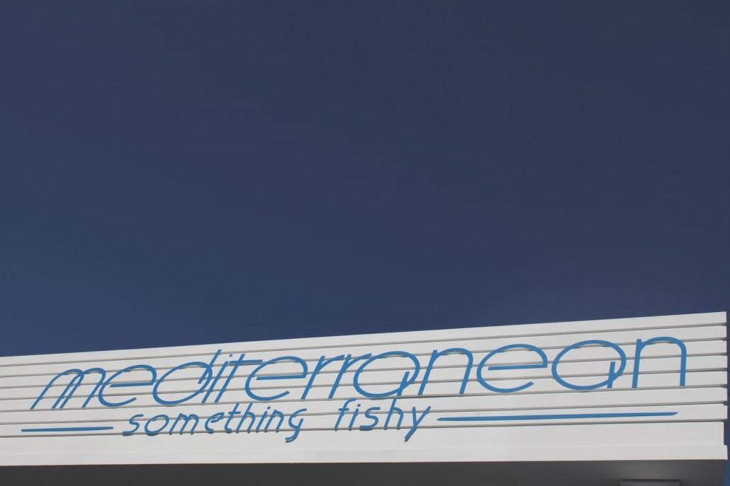 Mediterranean something fishy logo sign