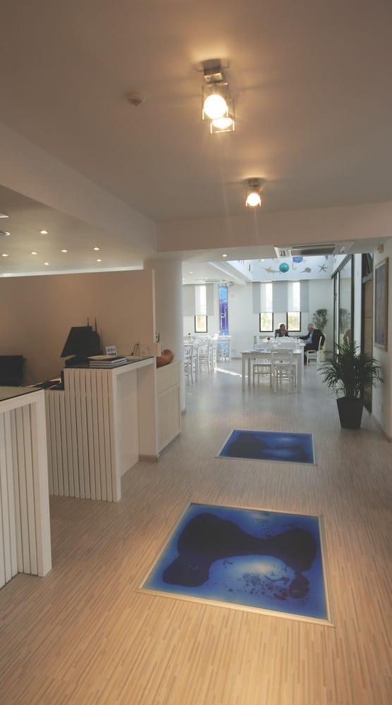 entrance responsive liquid floor tiles daytime