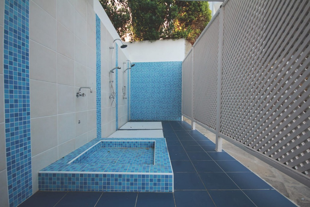 pool showers blue sand white