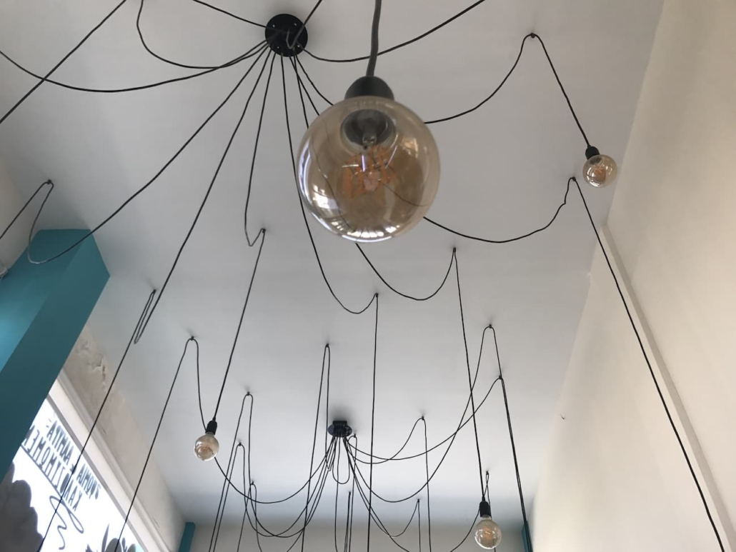 The chantelier is the main lighting source of the bakery and was inspired by a spider's web