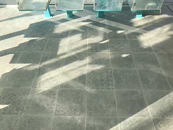 Light and shadow games and reflections on the retro ceramic tile floor