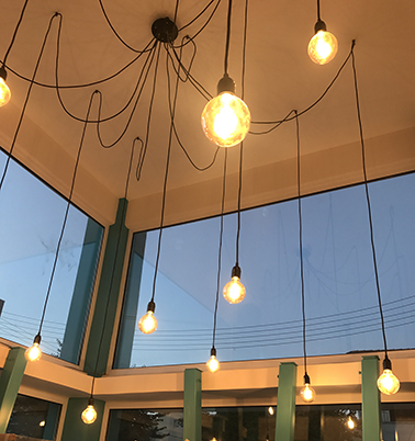 The warm light of the retro bulbs give the impression of an older building
